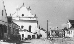 """<p>View of a street in Slonim leading upto the main synagogue. 1943.</p> <div id=""""record-identifiers""""></div>"""