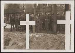 "<p>After the <a href=""/narrative/2317/en"">liberation</a> of the camp, the US Army ordered the local townspeople to bury the corpses of prisoners killed in the camp. This photograph shows troops observing a moment of silence at a mass funeral for victims of the <a href=""/narrative/7988/en"">Wöbbelin</a> camp. Germany, May 7, 1945.</p>"