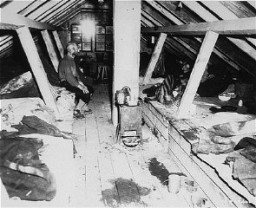<p>Forced laborers inside barracks soon after the liberation of Kaufering IV, part of a network of Dachau subcamps. Landsberg-Kaufering, Germany, 1945.</p>