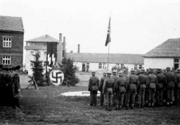 <p>Camp commandant Amon Goeth delivers a speech to SS guards in the Płaszów camp. Płaszów, Poland, 1943-1944.</p>