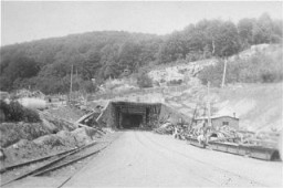 "<p>View of a tunnel entrance to the rocket factory at the <a href=""/narrative/4909/en"">Dora-Mittelbau</a> concentration camp, near Nordhausen. Germany, April-May 1945.</p>"