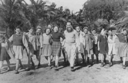 "<p>A group of Polish Jewish children (known as the ""<a href=""/narrative/11006/en"">Tehran Children</a>""), who arrived in Palestine via Iran, at the Mikveh Israel agricultural village. Palestine, February or March 1943.</p>"