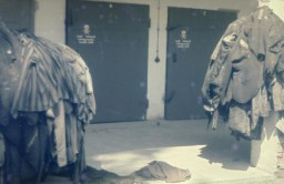 Prisoners' clothing and uniforms are piled in front of the doors to the crematoria in the newly liberated Dachau concentration camp