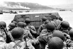 "<p>Assault troops in a landing craft approach Omaha Beach on <a href=""/narrative/2899/en"">D-Day</a>. Normandy, France, June 6, 1944.</p>"