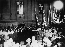 "<p>From a window in the Reich Chancellery, German president <a href=""/narrative/19342/en"">Paul von Hindenburg</a> watches a Nazi torchlight parade in honor of <a href=""/narrative/43/en"">Adolf Hitler</a>'s appointment as German Chancellor. Berlin, Germany, January 30, 1933.</p>"