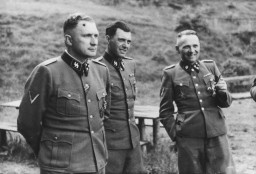 "<p>This photograph shows a group of <a href=""/narrative/10800"">SS officers</a> at Solahütte, the SS retreat outside of <a href=""/narrative/3673"">Auschwitz</a>. Pictured from left to right: Richard Baer, Dr. Josef Mengele, and Rudolf Höss.</p>