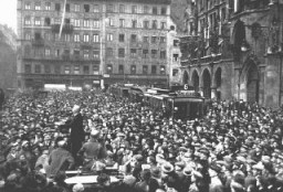 "<p>A large crowd gathers in front of the Rathaus to hear the exhortations of Julius Streicher during the <a href=""/narrative/11449/en"">Beer Hall Putsch</a>, Hitler's early unsuccessful attempt to seize power. Munich, Germany, November 1923.</p>"