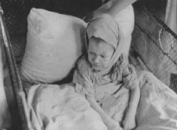 <p>A child in the Kovno ghetto hospital. Lithuania, between 1941 and 1944.</p>