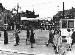 """<p>A billboard advertising an anti-Masonic exhibition organized by the anti-Masonic Belgian league, """"L'Epuration,"""" in the Masonic Supreme Council building. Brussels. Belgium, 1941.</p> <p>As part of their propaganda campaign against <a href=""""/narrative/10188/en"""">Freemasonry</a>, the Nazis and other local right-wing organizations mounted anti-Masonic exhibitions throughout occupied Europe. German-occupied Paris hosted an anti-Masonic exhibition in October 1940, as did German-occupied Brussels in February 1941.</p>"""