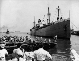 "<p>The Jewish refugee ship Pan-York, carrying new citizens to the recently established <a href=""/narrative/6306/en"">state of Israel</a>, docks at Haifa. The ship sailed from southern Europe to Israel, via Cyprus. Haifa, Israel, July 9, 1948.</p>"