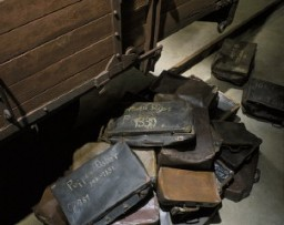 """<p>A collection of valises belonging to Jews who were <a href=""""/narrative/5041/en"""">deported to killing centers</a>. These valises are displayed at the base of the railcar on the third floor of the Permanent Exhibition at the United States Holocaust Memorial Museum. Washington, DC, 1993–1995.</p>"""