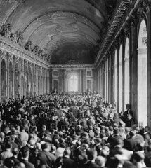 Allied delegates in the Hall of Mirrors at Versailles witness the German delegation's acceptance of the terms of the Treaty Of Versailles, ... [LCID: tl104]