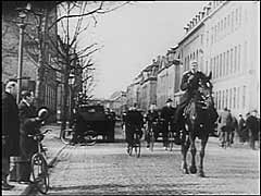 <p>Denmark signed a nonaggression pact with Germany in 1939, hoping to maintain neutrality as it had in World War I. Germany, however, broke the agreement on April 9, 1940, when it occupied Denmark. King Christian X remained on the throne, and the Danish police and government reluctantly accepted the German occupation. This footage shows the German presence in the occupied Danish capital, Copenhagen. In 1943, as German policies towards Denmark toughened, the Danes would form one of the most active and successful resistance campaigns against the German occupation.</p>