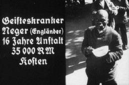 "<p>Slide to <a href=""/narrative/11357"">indoctrinate youth</a> taken from a Nazi propaganda filmstrip. Promoting ""euthanasia,"" it was prepared for the Hitler Youth. The caption says: ""Mentally ill Negro (English) 16 years in an institution costing 35,000 RM [Reichsmarks]."" Place and date uncertain.</p>"