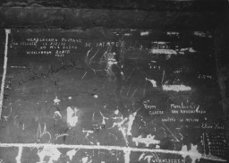 Prisoner names scratched on the wall of the Breendonk internment camp.