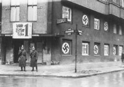 """<p>Policemen stand outside the shuttered Eldorado nightclub, long frequented by Berlin's <a href=""""/narrative/4631"""">gay</a> and <a href=""""/narrative/6695"""">lesbian</a> community. The Nazi government quickly closed the establishment down and pasted pro-Nazi election posters on the building. Berlin, Germany, March 5, 1933.</p> <p><a href=""""https://perspectives.ushmm.org/item/photo-of-the-eldorado-club"""">Learn more</a> about this photograph.</p>"""