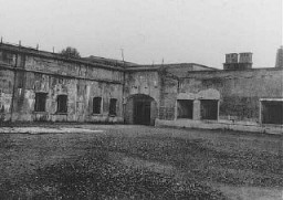 """<p>View of the courtyard in the <a href=""""/narrative/5377/en"""">Breendonk</a> fortress prison where prisoners lined up for roll call. Breendonk, Belgium, postwar.</p> <p>This image is taken from a series of snapshots sold on the site after the end of World War II.</p>"""