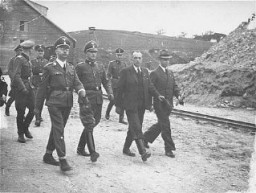SS chief Heinrich Himmler (front row, left) and Mauthausen commandant Franz Ziereis (second from left) inspect the Mauthausen concentration ... [LCID: 83476]