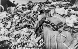 <p>Piles of prayer shawls that belonged to Jewish victims, found after the liberation of the Auschwitz camp. Poland, after January 1945.</p>
