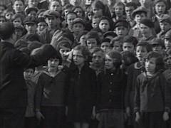<p>Large group of schoolchildren sing Hatikvah, the Zionist anthem.</p>