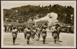 "<div class=""datapair"">A runner begins the torch relay (the first ""Olympia Fackel-Staffel-Lauf"") in Oympia, Greece., ca. July 1936.