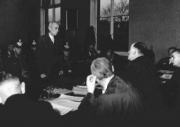 """<p>Eugen Bolz, a member of the Catholic opposition to Hitler, during his trial before the People's Court. He was arrested following the attempt to kill Hitler in <a href=""""/narrative/12002/en"""">July 1944</a> and was executed at Berlin's Ploetzensee prison on January 23, 1945.</p>"""