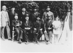 "<p>Leaders of the <a href=""/narrative/11710"">Sighet</a> Jewish community. Those pictured include Mr. Hershkovich (seated far left), Mr. Klein (seated second from left), Mr. Yacobovich (standing far right), and Mr. Jahan (standing second row, right). Photograph taken ca. 1928–1930.</p>"