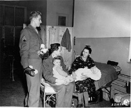 "<p>US Army and <a href=""/narrative/5002/en"">Joint Distribution Committee</a> (JDC) representatives distribute milk to refugees. Vienna, Austria, October 26, 1945.</p>"