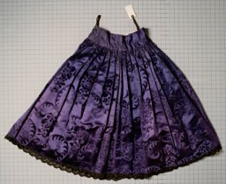 "<p>This taffeta and cotton skirt dates from the 1920s. It belonged to a Romani (Gypsy) woman who was born in Frankfurt, Germany, and who lived in Germany before the war. She was arrested by the Nazis and interned in the <a href=""/narrative/3673"">Auschwitz</a>, <a href=""/narrative/4015"">Ravensbrück</a>, <a href=""/narrative/3880"">Mauthausen</a>, and <a href=""/narrative/4549"">Bergen-Belsen</a> camps. She died in <a href=""/narrative/4549"">Bergen-Belsen</a> in March 1945, shortly before the camp's liberation. Her husband and two of her six children were also killed in the camps.</p>"