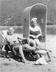 "<p><a href=""/narrative/9190/en"">Sophie</a>'s parents, Daniel and Laura Schwarzwald, pictured on a beach in Zaleszczyki, Poland, shortly after they were married. Poland, 1935.</p>"