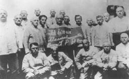 "<p>Humiliation of political prisoners: Social Democratic Party (SPD) inmates hold a placard which reads ""I am a class-conscious person, party boss/SPD/party boss."" <a href=""/narrative/4391/en"">Dachau</a> concentration camp, Germany, between 1933 and 1936.</p>"