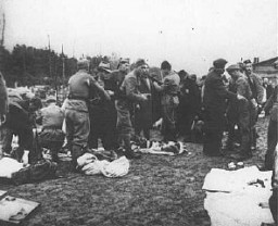 "<p>Ustasa (Croatian fascist) guards search prisoners and take their belongings upon arrival at <a href=""/narrative/5902/en"">Jasenovac</a> concentration camp. <a href=""/narrative/6153/en"">Yugoslavia</a>, between 1941 and 1945.</p>"