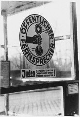 <p>Sign on a phone booth in Munich that prohibits Jews from using the public telephone. Munich, Germany, 1942.</p>