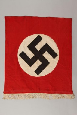 """<p>Nazi banner with a swastika.The swastikabecamethe most recognizable icon of Nazi<a href=""""/narrative/81/en"""">propaganda</a>, appearing on the Nazi flag,election posters, arm bands, medallions, and badges for military and other organizations.</p>"""