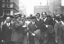 "<p>Dr. Bernard Deutsch, president of the <a href=""/narrative/7200"">American Jewish Congress</a> (center) and Rabbi <a href=""/narrative/10697"">Stephen S. Wise</a> (right) participate in a mass demonstration against Nazi treatment of German Jews. The demonstration took place on the same day as the <a href=""/narrative/7631"">book burnings</a> in Germany. New York, United States, May 10, 1933.</p>"