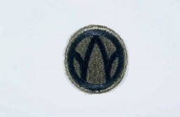 "<p>Insignia of the <a href=""/narrative/7836"">89th Infantry Division</a>. The 89th Infantry Division's nickname, the ""Rolling W,"" is based on the division's insignia. Created during <a href=""/narrative/28"">World War I</a>, this insignia utilized a letter ""M"" inside a wheel. When the wheel turns, the ""M"" becomes a ""W."" The letters ""MW"" signify the mid-west origin of the troops who formed the 89th during World War I. The division was also known as the ""Middle West"" division, another variation on its origin.</p>"