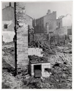 "<div class=""datapair"">A bombed out home in Warsaw, the besieged capital of Poland. Only a chimney and a stove remain relatively intact. Photograph taken by <a href=""/narrative/11384/en"">Julien Bryan</a> (1899-1974), a documentary filmmaker who filmed and photographed the everyday life and culture of individuals and communities in a variety of countries around the globe. In Warsaw following the German invasion of Poland, Bryan filmed and photographed the German bombardment and its impact on the Polish citizenry. He was able to leave during a brief truce that was negotiated to allow citizens of neutral countries to evacuate. Bryan was able to bring his films out, though for a time he got separated from his suitcase of film and thought they were lost. </div>