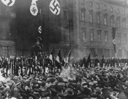 "<p>In <a href=""/narrative/5908/en"">Berlin</a>, thousands of Party officials, Hitler Youth members, and Labor Service leaders take an oath of loyalty read by Rudolf Hess in Munich and broadcast across Germany. Berlin, Germany, February 25, 1934.</p>"