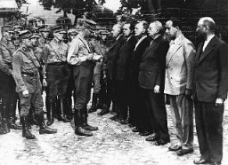 "<p>Arrival of <a href=""/narrative/11082/en"">political prisoners</a> at the Oranienburg <a href=""/narrative/4656/en"">concentration camp</a>. Oranienburg, Germany, 1933.</p>"