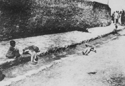 <p>Armenian children lie in the street of an unidentified town. Photograph taken by Armin T. Wegner. Wegner served as a nurse with the German Sanitary Corps. In 1915 and 1916, Wegner traveled throughout the Ottoman Empire and documented atrocities carried out against the Armenians. [Courtesy of Sybil Stevens (daughter of Armin T. Wegner). Wegner Collection, Deutsches Literaturarchiv, Marbach & United States Holocaust Memorial Museum.]</p>