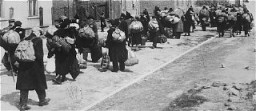"<p>Jews carrying their possessions during deportation to the <a href=""/narrative/3852/en"">Chelmno</a> killing center. Most of the people seen here had previously been deported to Lodz from central Europe. Lodz, Poland, January–April 1942.</p>"