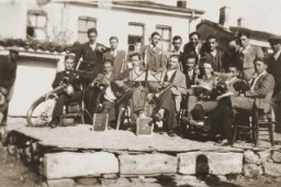 A group of Macedonian Jewish youth, members of a band, pose with their instruments on a makeshift stage in Bitola. [LCID: 97823]