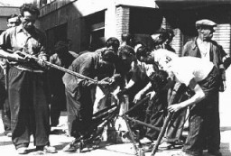 <p>Shortly before liberation by Allied forces, French resistance fighters staged uprisings across occupied France. Here, fighters gather arms during the Marseille uprising. Marseille, France, August 1944.</p>