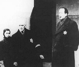 "<p>In a scene from a Nazi propaganda film, Dr. Paul Eppstein (right), Council of Elders chairman, addresses Dutch Jews. <a href=""/narrative/5386/en"">Theresienstadt</a> ghetto, Czechoslovakia, August 1944.</p>"