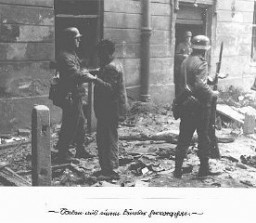 <p>A captured Jewish resistance fighter who was forced out of his hidden bunker by German soldiers during the Warsaw ghetto uprising. Warsaw, Poland, April 19-May 16, 1943.</p>
