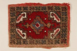 <p>This small patterned hooked rug was used as a shoe mat in the wagon of Rita Prigmore and her family when she was a child in Wurzberg, Germany, after World War II. Rita and her family were members of the Sinti group of Roma (Gypsies). She and her twin sister Rolanda were born in 1943. Rolanda died as a result of medical experiments on twins in the clinic where they were born. Rita was returned to her family in 1944. She and her mother survived the war and moved to the United States, before returning to Germany to run a Sinti human rights organization that sought to raise consciousness about the fate of Roma during the Holocaust.</p>