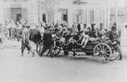 <p>Jewish women and children are transported by horse-drawn wagon during a deportation action in the Siedlce ghetto. During the liquidation of the ghetto on August 22-24, 1942, 10,000 Jews were deported to the Treblinka killing center. </p>