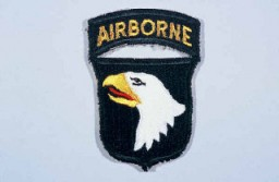 "<p>Insignia of the <a href=""/narrative/7949"">101st Airborne Division</a>. The nickname of the 101st Airborne Division, ""Screaming Eagles,"" originates from the division's insignia, a bald eagle on a black shield. ""Old Abe"" was the eagle mascot of a Wisconsin regiment during the Civil War. The 101st was formed as a reserve unit in Wisconsin shortly after World War I and included ""Old Abe"" as part of the division's insignia.</p>"