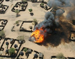 <p>Beginning of the burning of the village of Um Zeifa in Darfur after the Janjaweed looted and attacked. Photograph taken by Brian Steidle, December 2004.</p>