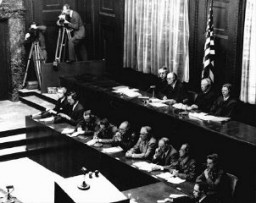 "<p>American judges (top row, seated) during the <a href=""/narrative/9245"">Doctors Trial</a>, case #1 of the Subsequent Nuremberg Proceedings. Presiding Judge Walter B. Beals is seated second from the left. Nuremberg, Germany, December 9, 1946–August 20, 1947.</p>"